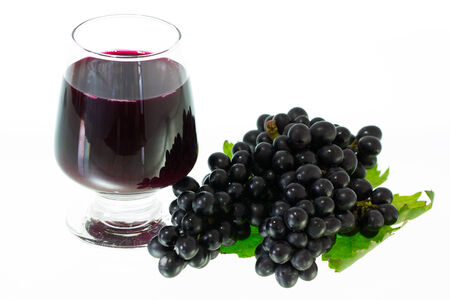 Ripe grapes and wine isolate on white background photo
