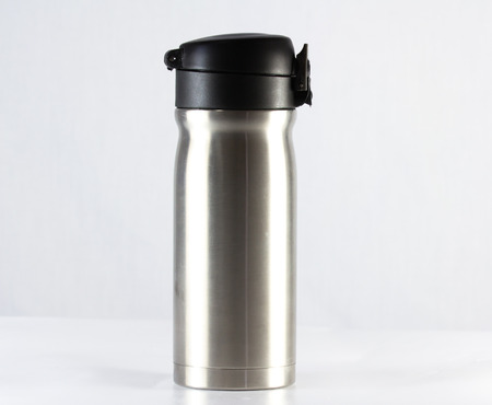 insulated drink container: Stainless vacuum bottle on white background Stock Photo