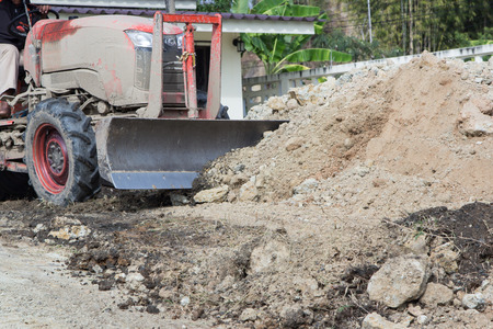 vibroroller: Steel wheeled compactor working the ground at a new housing development Stock Photo