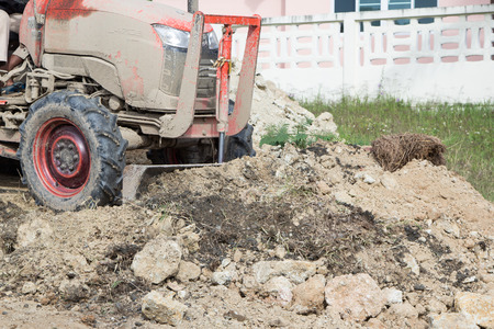 compacting: Steel wheeled compactor working the ground at a new housing development Stock Photo
