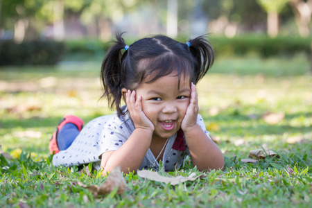 Cute little girl is playing in the park photo