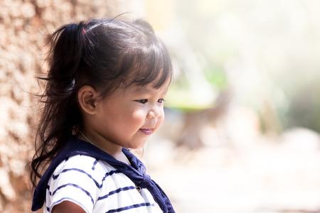 asian baby girl: Cute little girl having fun in the park