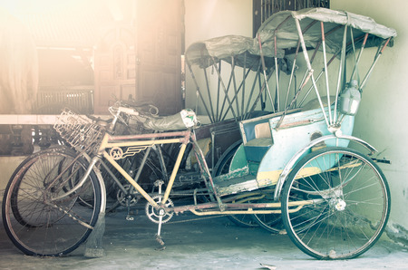 tricycle: Old three-wheeler,Thailand tricycle in vintage style Stock Photo