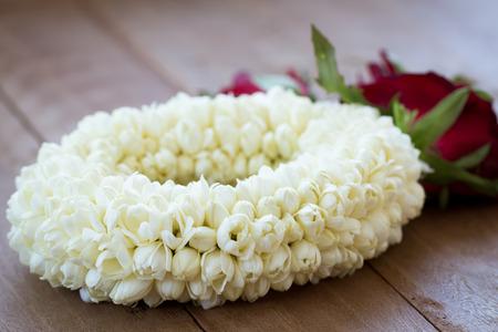 natual: beautiful Jasmine garland on wooden background