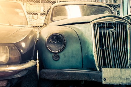 Old broken headlight of vintage car photo
