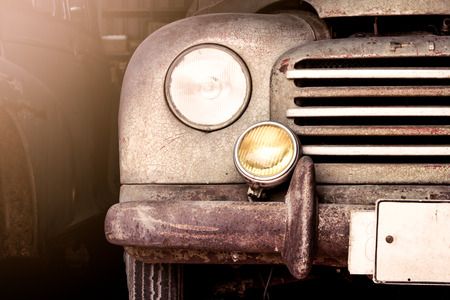Retro headlight of vintage car photo