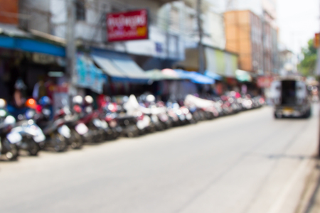 Blur image of motocycle park in big market,Chiangmai Thailand with bokeh photo