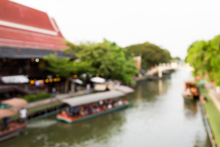 Blurred image of lifestyle at floating market in Thailand with bokeh photo