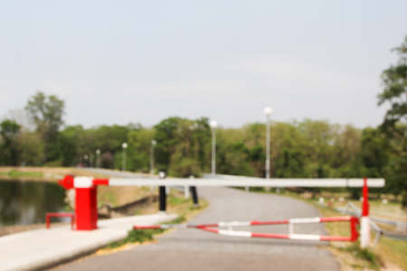 barrier gate: Blurred image of barrier gate with forest