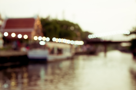 Vintage color of blurred image of lifestyle at floating market in Thailand with bokeh  photo