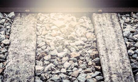 sleeper: old wooden sleeper on railway track in vintage filter