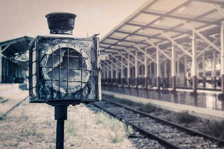 lamp on the pole: old lamp pole in railway station in vintage filter Stock Photo