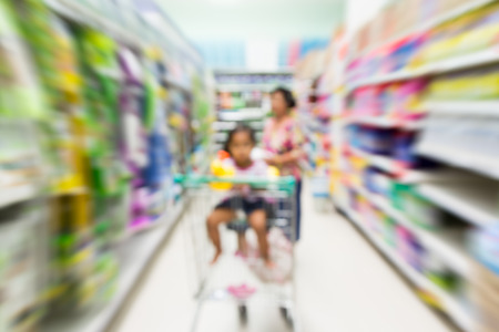 supermarket series: blurred image of family makes a purchase at the supermarket Stock Photo
