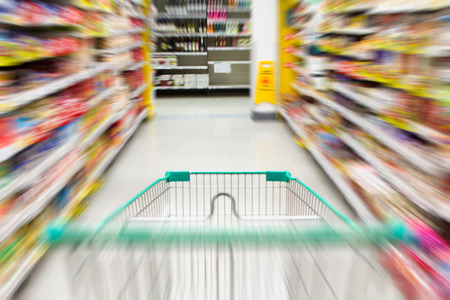 blurred image of shopping in supermarket with shopping cart Stock Photo