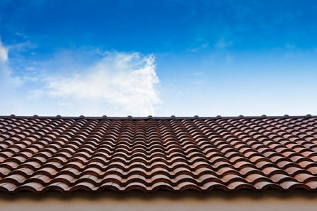 roof tiles: red tile roof blue sky Stock Photo