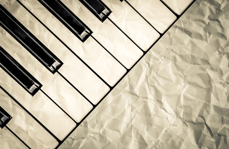 top veiw: top veiw of black and white piano keys with  wrinkled paper filter in vintage color tone,music concept