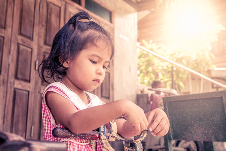 autism: upset little girl in outdoor in vintage color tone Stock Photo