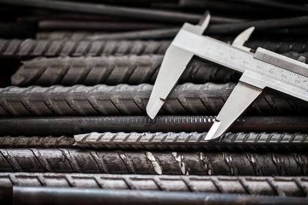 calibrate: Vernier Caliper, precision measurement tool put on steel Stock Photo