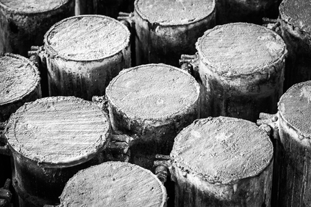 compaction: Concrete in steel cylinder formwork for testing of strength compaction in black and white