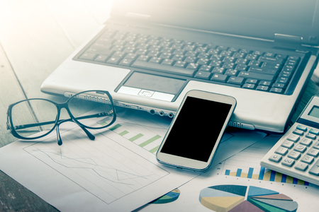 hp: Business concept,working, smart phone,tablet,cellphone with work tool on graph background in vintage color filter Stock Photo