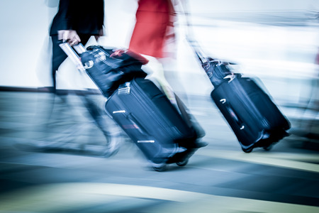 Blur motion of passengers walking at airport in blue color filter