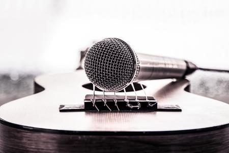 Microphone on acoustic guitar in dark tone