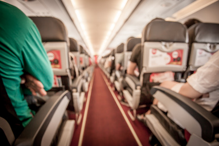 onboard: Blurred image of airplane interior in cabin,vintage color filter Stock Photo