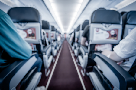 Blurred image of airplane interior in cabin,blue color filter Reklamní fotografie
