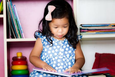 curly hair child: Child read, cute little girl reading a book on bookshelf background