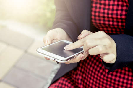woman on phone: Woman using cellphone,smart phone,phone in the park Stock Photo