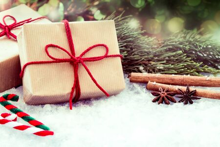 christmas shopping: Christmas presents with decoration on snow in vintage style Stock Photo