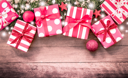 presents: Christmas presents with decoration on wooden table in vintage color filter