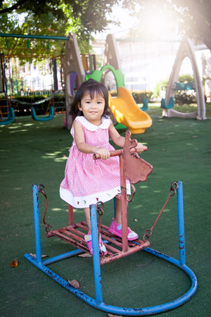 children play: Child asian little girl having fun to play with toy in children playground