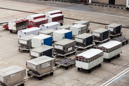 luggage containers in the airport Stock Photo