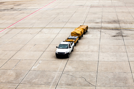 car with luggage containers in the airport