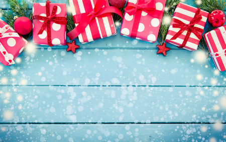 Christmas presents with decoration on blue wooden table in vintage color filter