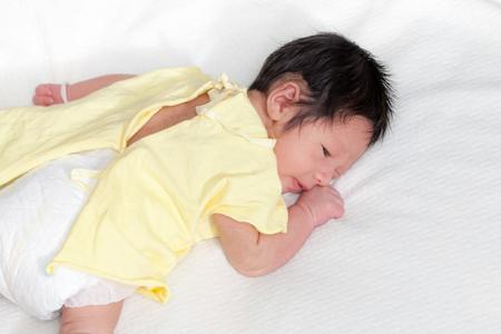 prone: Cute newborn baby boy lie prone on his bed