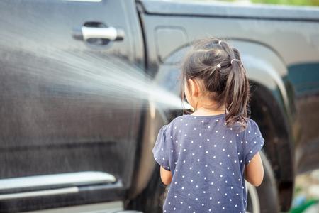 Cute asian little girls helping parent washing a car Stock Photo