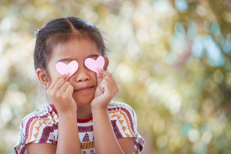 Cute asian little girl with hearts on the eyes