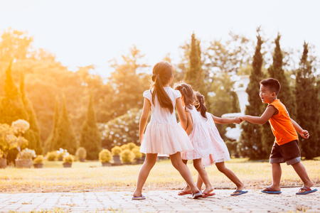Asian children holding hand and walking together in the park in vintage color tone Stock Photo