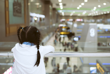 Cute asian child girl waiting for boarding in the airport