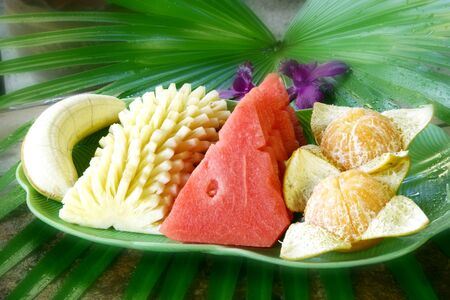 thai fruit set in plate with palm   photo