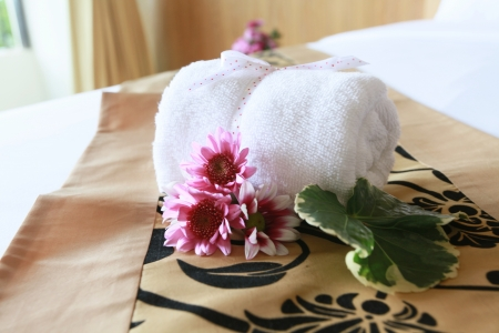 Decorative towel folding on the bed. photo