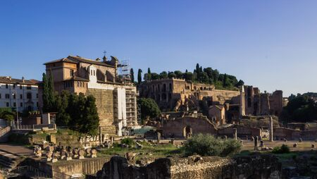 past civilizations: The ruins of the ancient city of Rome in the summer under a blue sky