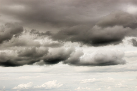 ominous: heavy dark ominous storm clouds Stock Photo
