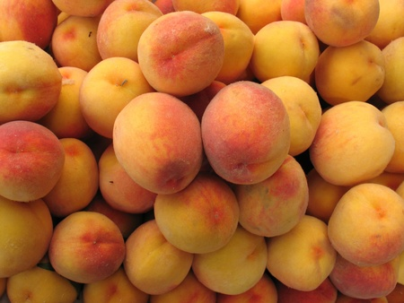 red and yellow peaches on the counter market in late summer Stock Photo
