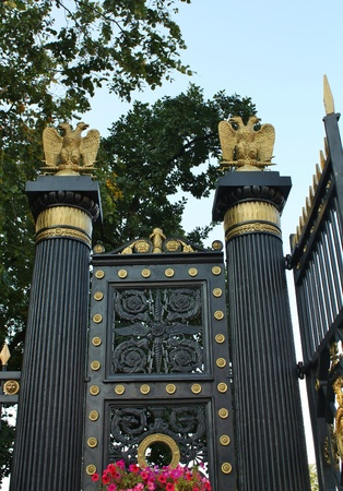 Gold double-headed eagle - the decorating of the entrance gate to the Alexander Garden in Moscow