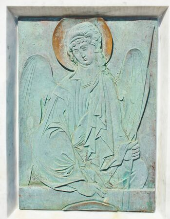Engraving on copper of green color with a picture of the orthodox Archangel  photo