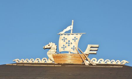Pagan symbol of seafarers - a boat with a horse photo