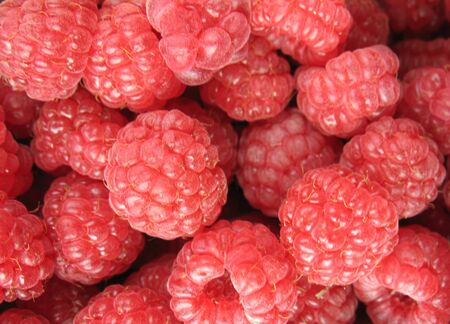 Red raspberries exposed for sale on the market